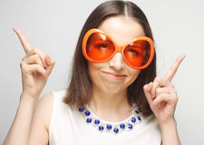 Young happy woman with big orange sunglasses Stock Photography
