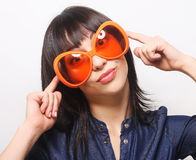 Young happy woman with big orange sunglasses Stock Images