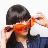 Young happy woman with big orange sunglasses Royalty Free Stock Photos