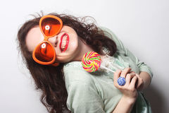 Young happy woman with big orange sunglasses Royalty Free Stock Image