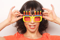 Young happy woman with big orange sunglasses Royalty Free Stock Photography