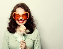 Young happy woman with big orange sunglasses Stock Photos