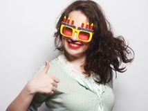 Young happy woman with big orange sunglasses Royalty Free Stock Photo