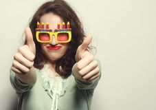 Young happy woman with big orange sunglasses Stock Photo