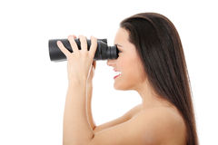 Young happy woman with binocular Stock Photo