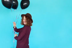 Young happy woman with black balloons having a birthday Royalty Free Stock Image