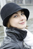 Young happy woman in black hat Royalty Free Stock Images