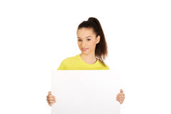 Young happy woman with blank board. Royalty Free Stock Photo