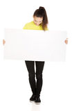 Young happy woman with blank board. Royalty Free Stock Images