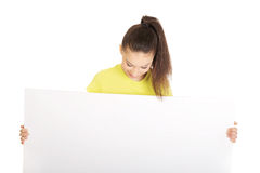 Young happy woman with blank board. Stock Photo