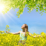 Young happy woman on blooming rapeseed field Royalty Free Stock Photography