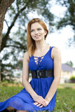 Young happy woman in blue dress Royalty Free Stock Images