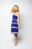 Young happy woman in blue dress jumping Royalty Free Stock Image