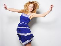 Young happy woman in blue dress jumping Stock Images