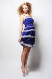 Young happy woman in blue dress jumping Stock Photography
