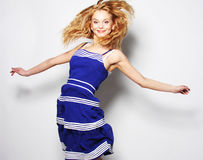 Young happy woman in blue dress jumping Stock Photo