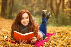 Young happy woman with book Stock Photos