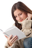Young happy woman with book wearing turtleneck Royalty Free Stock Photography