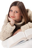 Young happy woman with book wearing turtleneck Royalty Free Stock Photo