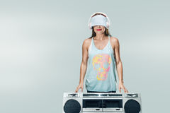 Young happy woman with boombox Royalty Free Stock Photos