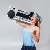 Young happy woman with boombox Royalty Free Stock Photo