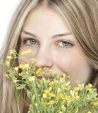 Young happy woman with bouquet Stock Image