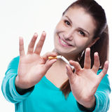 Young happy woman with broken cigarette. Stock Image