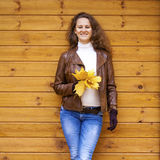 Young happy woman in brown leather jacket Stock Images