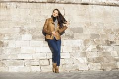Young happy woman in brown leather jacket royalty free stock images