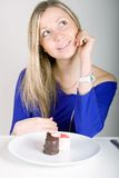 Young happy woman with cake Royalty Free Stock Image