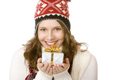 Young happy woman with cap holding Christmas gift Stock Photos