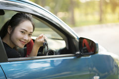 Young happy woman in car Royalty Free Stock Images