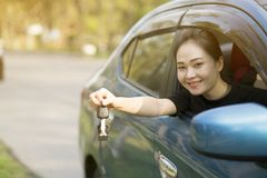 Young happy woman in car with sunlight Stock Photos