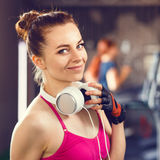 Young happy woman at cardio area in fitness center Royalty Free Stock Photo