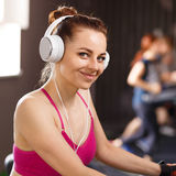 Young happy woman at cardio area in fitness center Stock Images