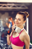 Young happy woman at cardio area in fitness center Royalty Free Stock Photography
