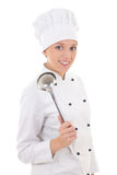 Young happy woman in chef uniform with big metal spoon isolated Royalty Free Stock Photo