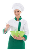 Young happy woman in chef uniform with corolla and bowl isolated. On white background stock photo