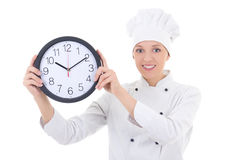 Young happy woman chef in uniform holding office clock isolated Royalty Free Stock Image