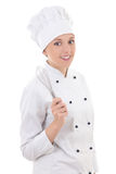 Young happy woman in chef uniform holding whisk isolated on whit Stock Image