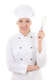 Young happy woman in chef uniform with whisk isolated on white Royalty Free Stock Photography