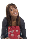 Young happy woman with Christmas gift Royalty Free Stock Images