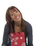 Young happy woman with Christmas gift Royalty Free Stock Photography
