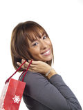 Young happy woman with Christmas gift bag Royalty Free Stock Photos
