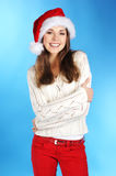 A young and happy woman in a Christmas hat Royalty Free Stock Images