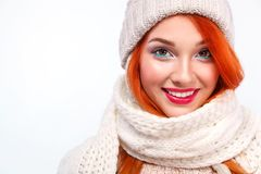 Closeup portrait of beautyful redhead happy woman on white background. Christmas and New Year concept. Young happy woman in christmas hat showing gift on red Royalty Free Stock Photos