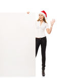 Young and happy woman in a Christmss hat with a banner Stock Photo