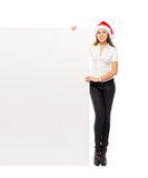 Young and happy woman in a Christmss hat with a banner Royalty Free Stock Photo