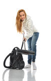 Young happy woman cleaning home floor with vacuum cleaner Royalty Free Stock Image
