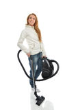 Young happy woman cleaning home floor with vacuum cleaner Royalty Free Stock Photography